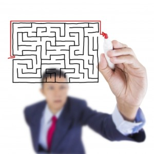 Business man finding way out of a maze