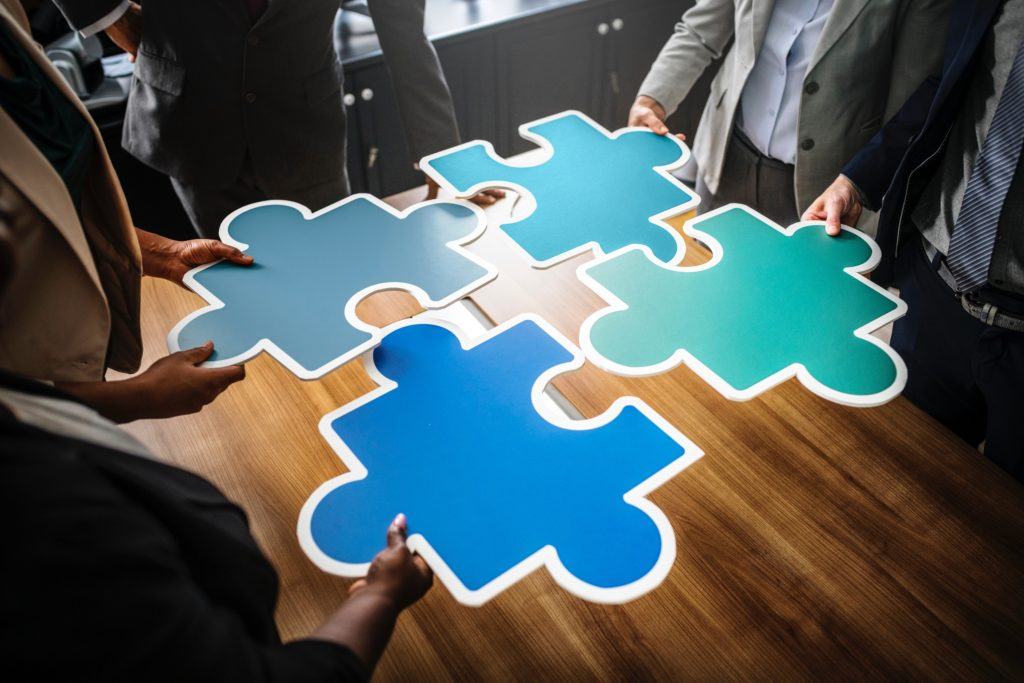 People putting business puzzle pieces together
